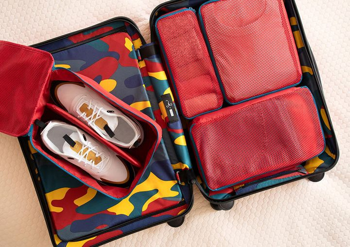 The collection features two suitcases, packing cubes and a shoe cube.